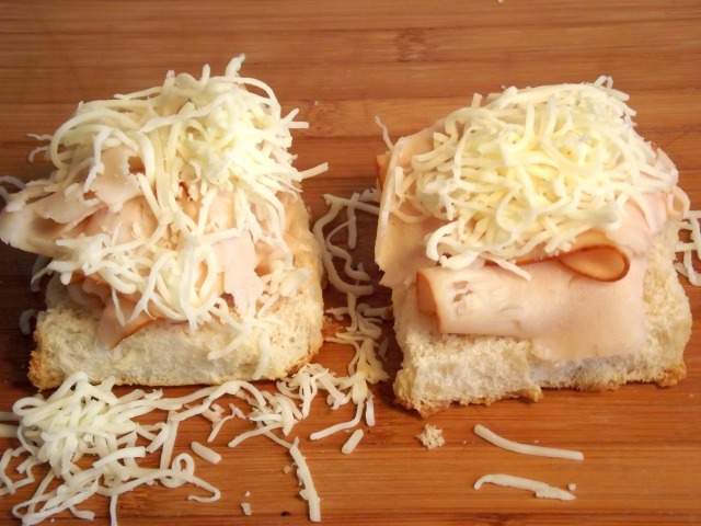 Add some of cheese , and   set aside. Then drizzle the dressing onto it